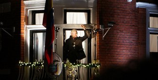 Image: Julian Assange waves from Ecuadorian embassy in Knightsbridge, London, UK.