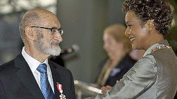 Photo: Henry Morgentaler has his Order of Canada pinned on his chest by Governor General Michaelle Jean in 2008.