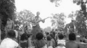 Image: Pete Seeger sings with his five-string banjo at Brampton's Camp Naivelt in the summer of 1955. Photo via Barbara Blaser / Winchevsky Centre.