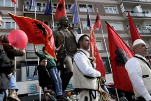Image: Kosovars hold Albanian flags as they take part in celebrations marking the 6th anniversary of Kosovo's declaration of independence from Serbia, in Pristina on February 17, 2014. (AFP Photo / Armend Nimani).