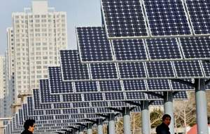Image: Pedestraians beneath row of solar panels, photo: AFP/Getty.