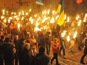 Nationalists hold torches during a march in the western Ukrainian city of Lviv on Jan. 1, 2014, as they mark the 105th anniversary of the birth of Stepan Bandera.(Photo: Yuriy Dyachyshyn, AFP/Getty Images)